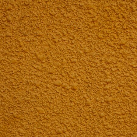stucco: a square of yellow painted stucco