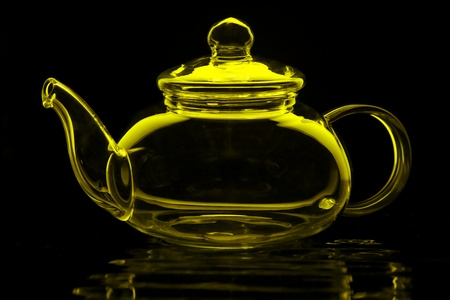 Glass teapot in lime green isolated on black Stock Photo