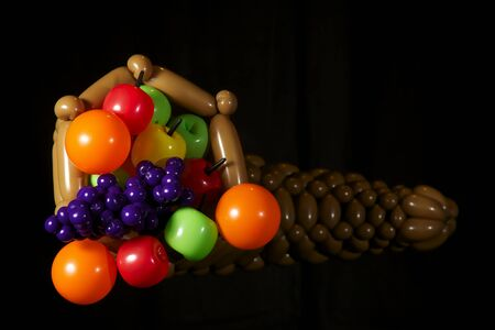 Horn of Plenty made out of balloons isolated on black Stock Photo