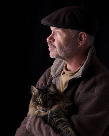 Older gentleman holding his cat