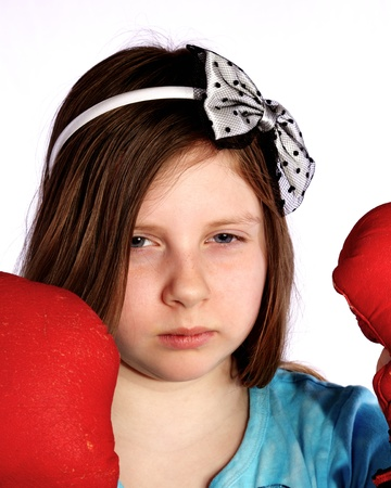 Young girl wearing boxing gloves and game face
