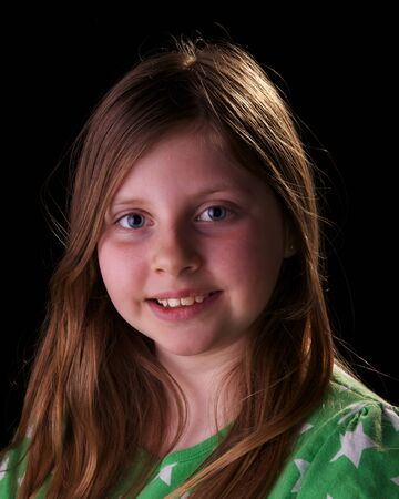 young girl wearing green top on black background