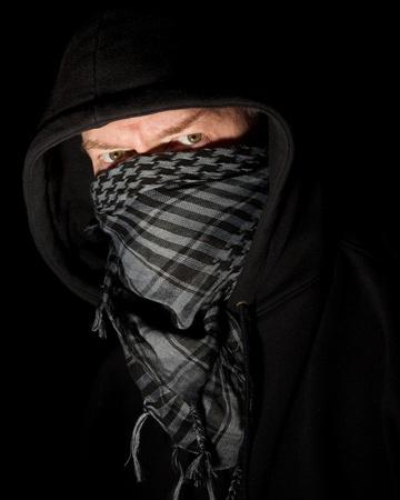 Masked robber portrait on black