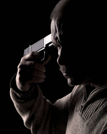 Man holding gun to his head Stock Photo