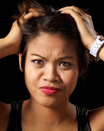 Asian woman looking very frustrated
