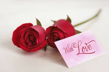 Roses and card written With Love Stock Photo