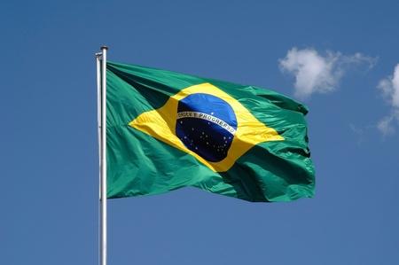 Flag of Brazil in blue sky