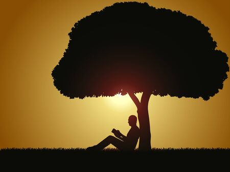 man outdoors: Silhouette - Readind book under a tree
