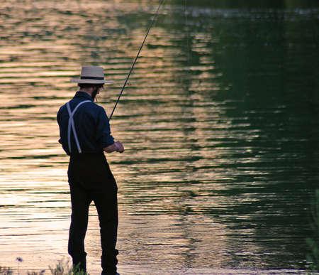 amish: Amish man fishing Stock Photo