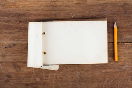 Antique 1943 year Old Grunge Notepad on Wooden background photo