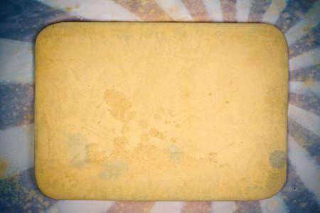 Old paper frame on sunburst grunge retro background photo
