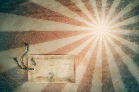 Sunburst retro grunge background with gift tag photo
