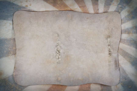 Sunburst retro grunge background with old paper sheet photo