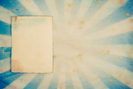Sunburst retro grunge background with photo frame photo