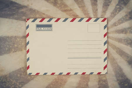 Envelope on sunburst grunge retro background photo