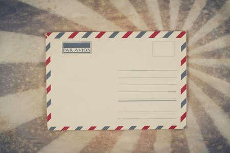 Envelope on sunburst grunge retro background photo
