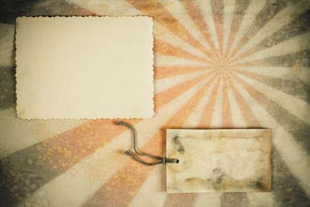 Sunburst retro grunge background with photo frame and gift tag photo