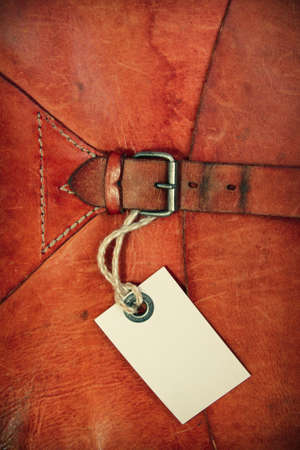 Vintage leather textured background with gift tag photo