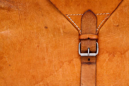 Vintage leather textured background with a belt