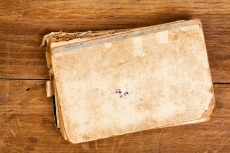 Antique book on wood background photo