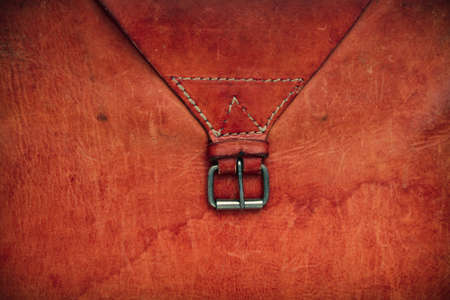 color skin brown: Old leather textured background with a belt Stock Photo