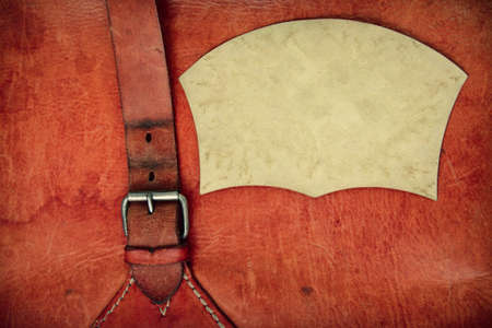 Leather vintage background with a buckle and frame photo