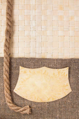 splice: Paper frame on wicker rattan and canvas with rope background
