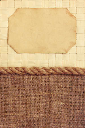 Paper frame on wicker rattan and canvas with rope background photo