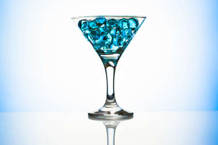 Martini glass with blue water gel beads photo