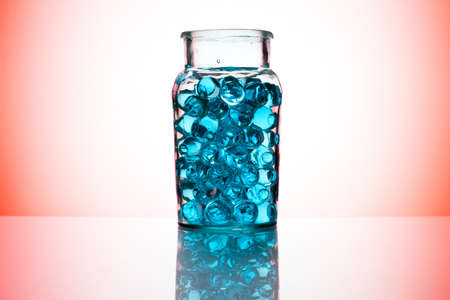Blue water gel beads in glass cup photo