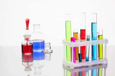 Laboratory glass test tubes with color liquid on white background Stock Photo - 15366381