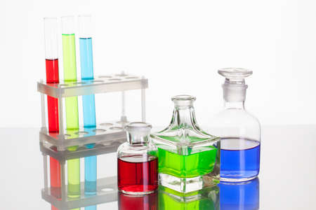 Laboratory glass test tubes with color liquid on white background Stock Photo - 15779344