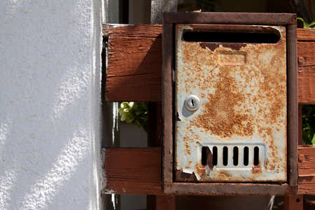 Old grunge rusted metal mailbox photo