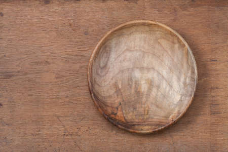Vintage empty, wooden plate on oak wood texture background photo