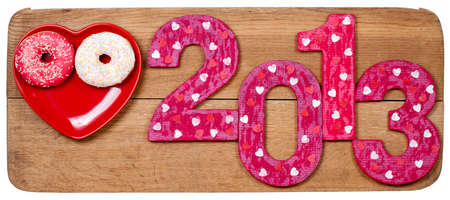 New Year 2013 snake date on wooden texture background photo