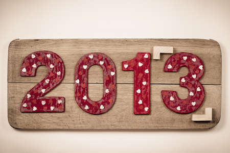Vintage New Year 2013 date on wooden board background photo