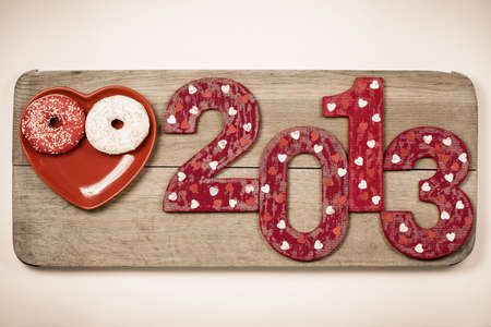 Vintage New Year 2013 snake date with on wooden board photo