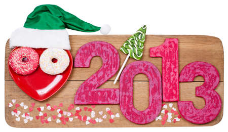 Vintage New Year 2013 snake date on wooden texture background photo
