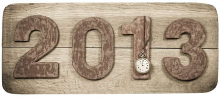 Vintage New Year 2013 date and pocket watch on wooden board background photo