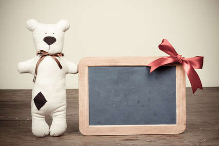 Handmade toy bear, wooden black board with bow vintage   photo