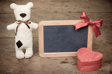 Heart shape box, handmade toy bear, wooden black board with bow vintage photo photo