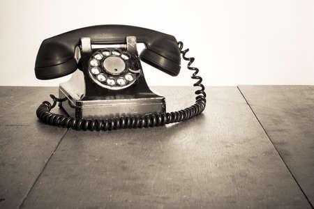 Vintage black telephone on old table