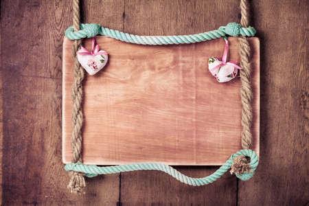 large doors: Vintage Valentine frame background with hearts hanging on rope