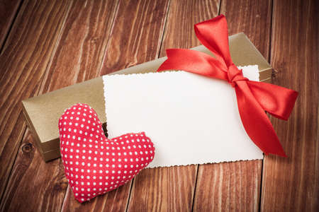 Valentine card with heart and gift box photo