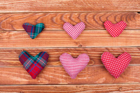 Handmade Valentine  hearts on wooden background Stock Photo - 17836100
