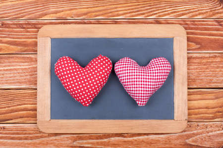Two Valentine hearts in frame photo
