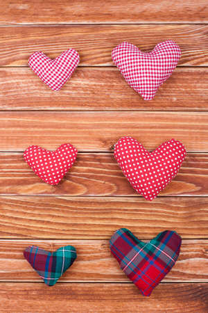 Handmade Valentine hearts on wooden background photo