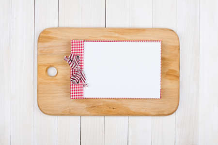 Recipe book, kitchen plank on white wood background photo