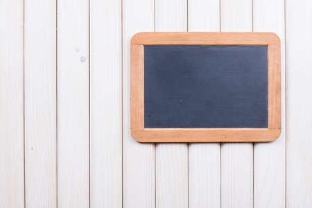 Blackboard on wooden wall background Stock Photo - 18090377