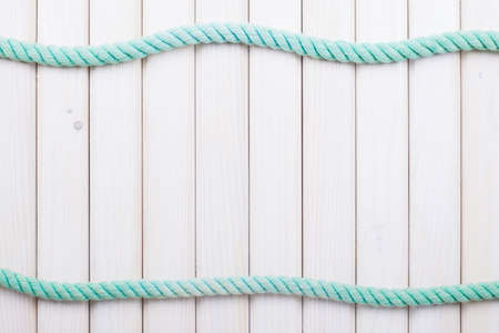 White wooden planks with rope background Imagens